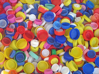 recycling of a collection of colored plastic caps for bottles