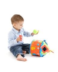 Little kid with developmental toy