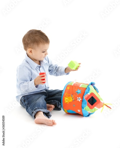 Little kid with developmental toy