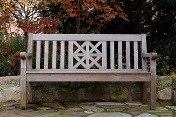 Teak Wood Bench in Fall Landscape