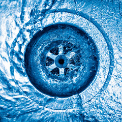 Swirl of water going down the sink