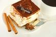 Cake tiramisu and a cup of hot coffee