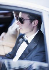 Celebrities sitting in backseat of car
