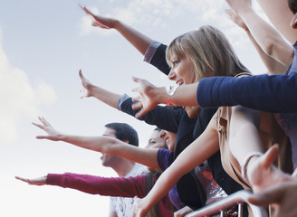 Fans waving from behind barrier