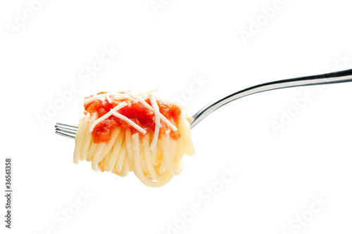 Fork with spaghetti, tomato sauce and cheese