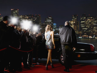 Celebrity walking to car on red carpet