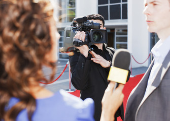 Cameraman taping celebrity on red carpet
