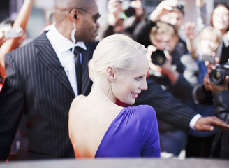 Bodyguard protecting celebrity on red carpet