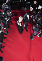 Celebrities working on red carpet