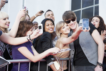 Celebrity taking pictures with fans