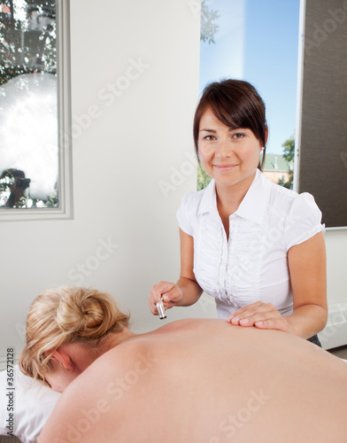 Acupuncturist Using Plum Blossom Tool