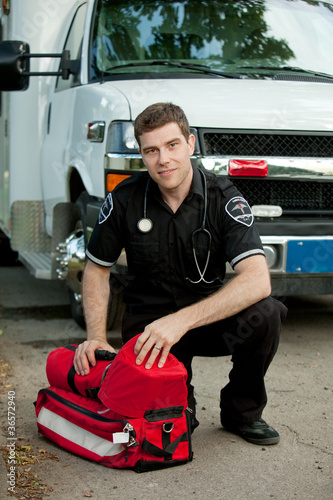 Paramedic with Portable Oxygen Unit
