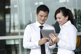 Asian business people using touch-pad tablet