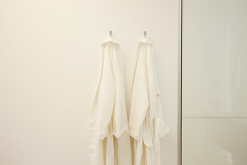 Bathrobes hanging from hooks