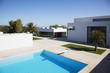 Pool outside modern house