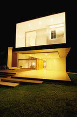 Modern house lit up at night