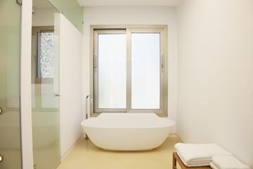 Upright bathtub in modern bathroom