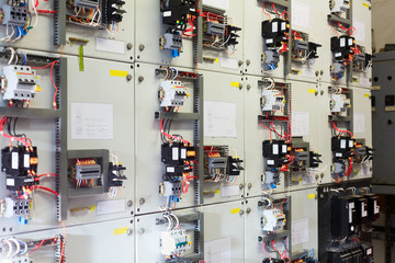 Electric service panel with many switches and breakers