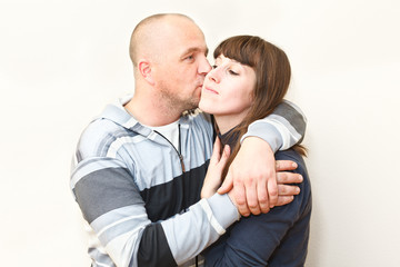 Loving couple kissing and embracing together