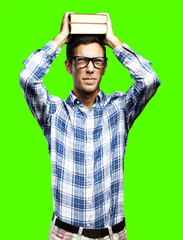 man holding books against a removable chroma key background