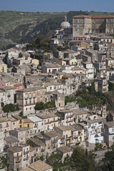 City of old buildings on hillside