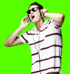 man with headphones over removable chroma key background