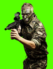 young soldier aiming over removable chroma key background