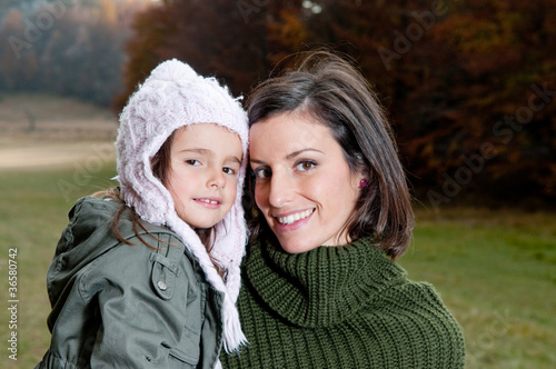 Happy mother and daughter in nature
