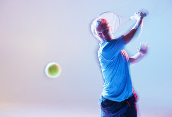 Blurred view of tennis player swinging racket