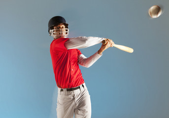 Blurred view of baseball player swinging bat