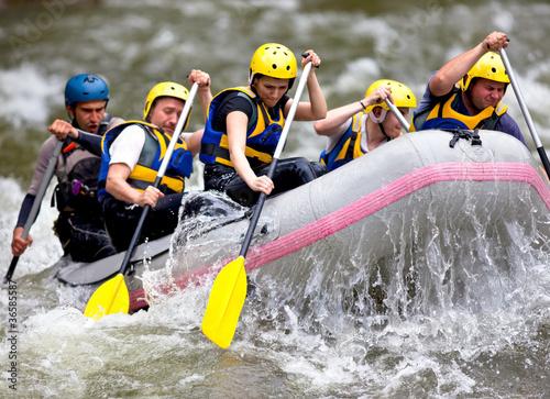 Leinwandbild Motiv Group of people whitewater rafting