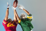 Blurred view of football players reaching for ball