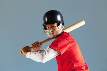 Baseball player holding bat