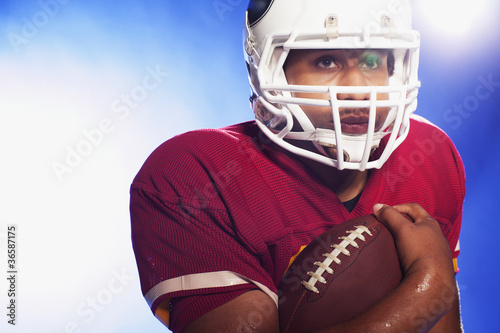 Football player carrying ball