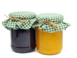 plum jam and honey in glass jars