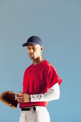 Baseball player holding ball and glove