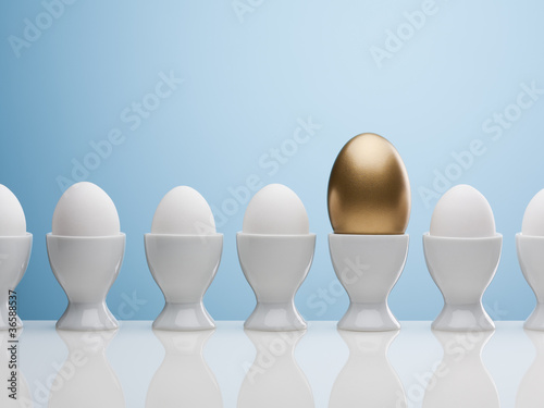 Golden egg in egg cup