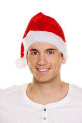 Mann mit Mütze eines Weihnachtsmannes