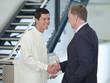 Businessman shaking hands with scientist