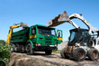 Two excavators loaded dumper