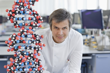 Scientist with molecular model in lab