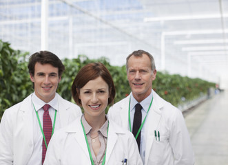 Scientists smiling in greenhouse