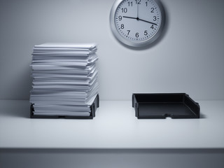 Stacks of paper on office desk