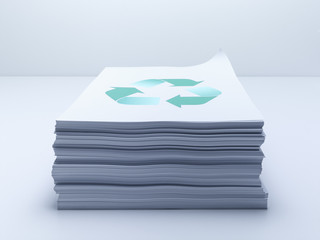 Stack of paper with recycling symbol