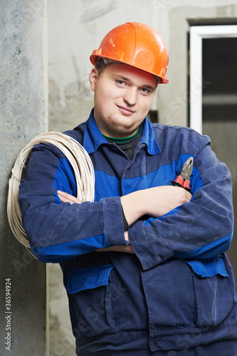 Portrait of young Electrician in uniform