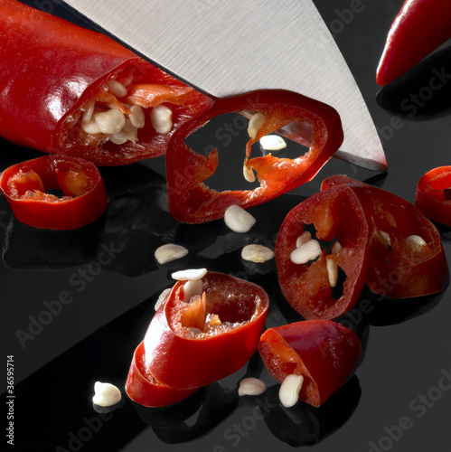 sliced chillies and blade