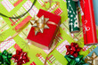 Wrapping paper, bows, and a red box