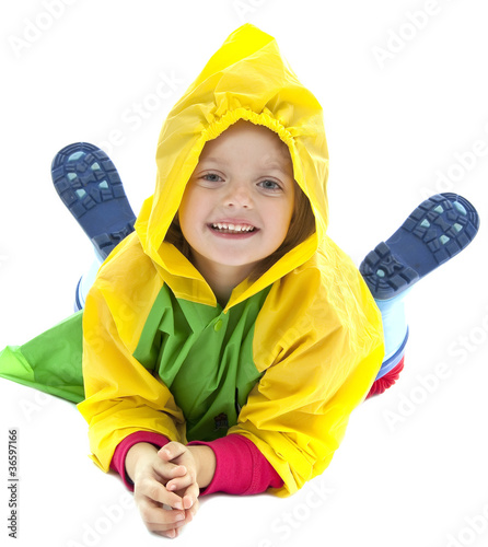 little girl with raincoat and gum boots