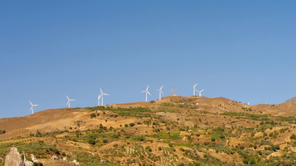 Wind turbines in the mountains, Greece.