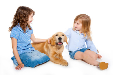 kid girls with Golden retriever puppy isolated